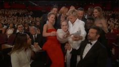 When the ultimate celebrity selfie was being organized... | The 27 Best Moments From The 2014 Academy Awards
