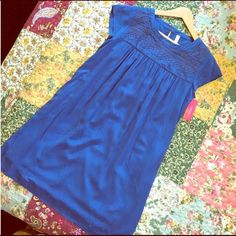 """NWT Blue Xhilaration dress Never worn. Embroidery on neckline, cap sleeves, pleated chest. Has built-in slip. Single button closure in back. Length is 34"""" from back of neck to bottom. Body 100% rayon. Xhilaration Dresses"""