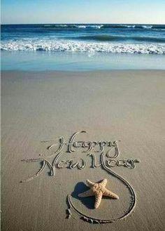 Happy New Year.Written in the Ocean Beach Sand.