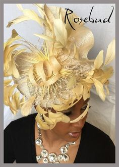 Fabulous feathered fascinator. natural color. exchange only no cash refunds allowed