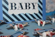Plane favors made from gum, smarties and lifesavers. Easy and adorable!