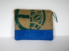 Large printed burlap zipped bag with bright blue leather details