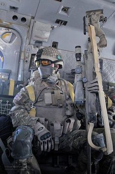 British Army Sniper from the 1st Battalion, Royal Irish Regiment onboard a Royal Air Force Merlin helicopter in Helmand province, Afghanistan in support of Operation Herrick.