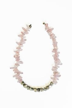 Independence Avenue Necklace  This natural rose quartz tusk stone necklace features 11 raw unpolished pyrite beads in the center and has an antique brass button clasp. The necklace hangs near the collarbone.  Perfect to wear on its own or layered with one of my long pyrite necklaces.