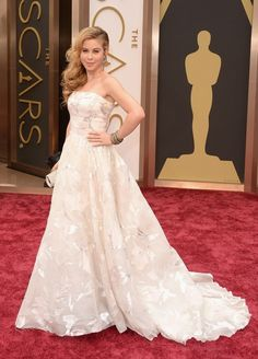 Tara Lipinski | Fashion On The 2014 Academy Awards Red Carpet - She looks like a mound of snow that's collecting outside my window right this moment. The dress is pretty, but the accessories and hair (the hair, oh God) take it to prom territory.