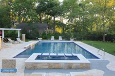 KrystalKrete French Gray is plastered in this rectangular pool to match the curved gray pavers surrounding the pool. A Pinterest favorite by Rosebrook Pools! Libertyville, Illinois #swimmingpool #pool