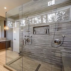Bathroom frameless shower glass enclosure is beautiful. Love the shampoo bottle compartment between the two shower heads
