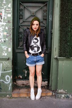 How to Wear a White T-Shirt #2: Rock the hell out of it with denim shorts, edgy jacket, add a beanie for a nice final touch. Not sure about shoes... chucks work here, but wondering if you could pull off with gladiator-type sandals or flats? Maybe not flats.