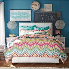 Blue walls, girl room, striped bedding