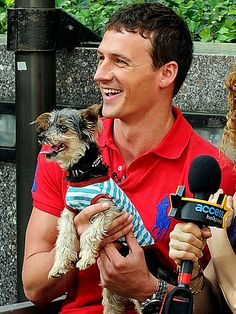 Ryan Lochte with a puppy?!? Seriously, can he be any cuter? http://www.people.com/people/gallery/0,,20623882,00.html#21204499