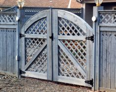Good Neighbor Arched Lattice Double Gate By Elyria Fence Wood Fence Gates, Driveway Fence, Garden Gates And Fencing, Deer Fence, Driveway Landscaping, Double Wooden Gates, Double Gate, Backyard Privacy, Metal Pergola