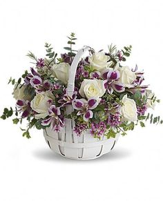 Sweet Moments basket of purple and white flowers.