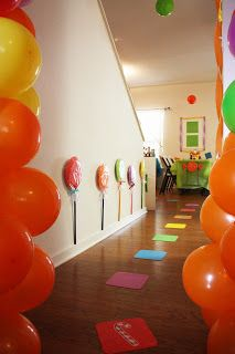 Candyland theme birthday--huge lolipops using painted paper plates and painted wooden dowels!!
