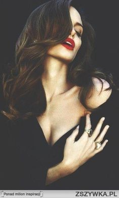 Angelina Jolie- black, red lips, and gorgeous hair. She is the definition of class