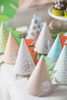 Cool party hats at a dinosaur birthday party! See more party planning ideas at CatchMyParty.com!