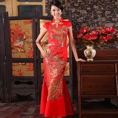 CHINESE - The traditional Chinese wedding dress in northern Chinese usually is one piece frock named Qipao, embroidered with elaborate gold and silver design.
