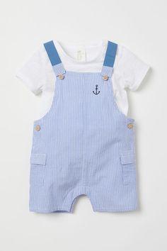 Set with a T-shirt and bib overall shorts in soft organic cotton fabric. T-shirt in soft slub jersey. Bib overall shorts with buttons at sides elasticized suspenders with button patch pockets with flap and snap fasteners at gusset. Cute Boy Outfits, Little Boy Outfits, Cute Baby Clothes, Baby Boy Outfits, Kids Outfits, Little Boys Clothes, Babies Clothes, Babies Stuff, Winter Outfits