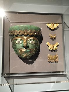 Left, burial mask; right, nose ornaments, Moche people, Tomb 2, Dos Cabezas, Peru, 525-550 CE, Metropolitan Museum of Art