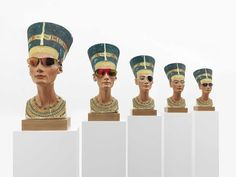 """Isa Genzken, """"Nofretete"""", 2014, 7 Nefertiti plaster busts with glassed on wooden bases, wooden plinths on casters and 4 steel panels, each 190 x 7 x 40 x 50 cm, installation dimensions variable, Courtesy Galerie Buchholz, Cologne/Berlin/New York, David Zwirner, New York/London and Hauser & Wirth"""