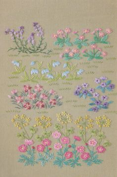 Hand embroidery of flowers in the garden