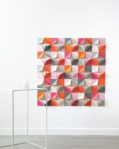 Folded-Paper Wall Backdrop How-To. This would be so amazing to add texture and color to a baby's room.