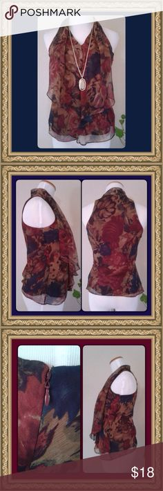 🍂🍁Elegant Floral Top by Ralph Lauren🍁🍂 Beautiful, muted floral top by Ralph Lauren.  Gorgeous palette in shades of Dark Teal, Wine, Nutmeg & Sandalwood.  Lovely piece for your autumn wardrobe.  Fitted style, cutaway sleeveless, side zipper with hook & eye fastener.  Draped detailing falls across neckline.  100% polyester shell, wine lining. Pretty pleated neckline in back (see photo).  Size 2P, measures | Chest (armpit to armpit) 18"