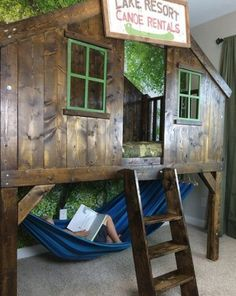 camping clubhouse loft bed for a kid with a hammock under it