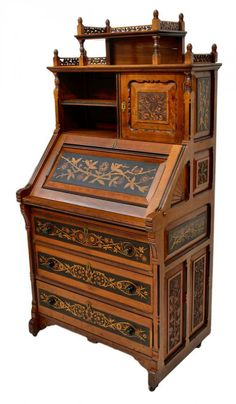 American Drop Front Desk, Aesthetic Movement, c. 1875, Decorated with carved & inlaid flowers, finials & fan carving. Hardware stamped G. Bayer, Feb. 6, 1872, New York City