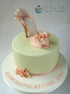"I was so excited when I took this order.  The shoes are loosely based on a shoe in the movie ""Burlesque"",  and I am so glad of a sophisticated cake for a hen party!  Lemon sponge with lemon buttercream.  www.facebook.com/cleverlittlecupcake"
