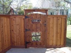 Gorgeous backyard or front yard gate and fence.- Gorgeous backyard or front yard gate and fence. Love the overhang and Iron accen… Gorgeous backyard or front yard gate and fence. Love the overhang and Iron accents! Backyard Gates, Garden Gates And Fencing, Backyard Pergola, Fence Gates, Pallet Pergola, Outdoor Gates, Gates Driveway, Fence Doors, Cedar Fence