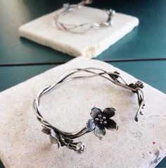 Bring nature right by your palm with a subtle touch of petals. Silver Bracelets, Silver Earrings, Silver Jewelry, Cherry Flower, Leaf Jewelry, Flower Bracelet, 925 Silver, Silver Ring, Special Occasion