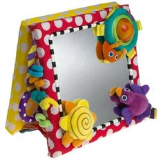 ToyS that encourage tummy time and crawling:  Sassy Me In The Mirror by Sassy, http://www.amazon.com/dp/B000069670/ref=cm_sw_r_pi_dp_.z4Trb1AM9A9Z
