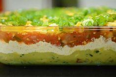 5-layer Keto Dip: Guacamole, sour cream, salsa, cheese. Dip carrots, broccoli, cauliflower, lettuce leaves