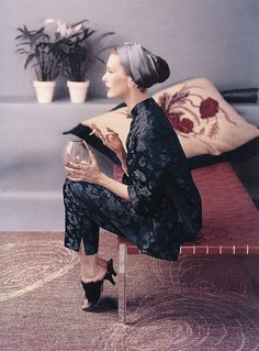 Chinoiserie style silk pajamas could be worn to host a party. Model Mary Jane Russell modeled them with a turban in Vogue in 1953.