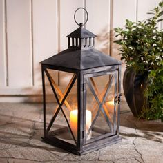 Add gentle, flickering candlelight to your backyard or cottage patio. These traditional designed candle lanterns add an antique look to your outdoor space.