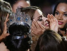 * The year's Best Photojournalism * Contestants comfort Miss Colombia Ariadna Gutierrez after she was mistakenly crowned Miss Universe, and then declared the first runner-up, in Las Vegas, on 2015 Dec. 20.
