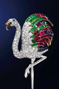1940 flamingo brooch, made by Cartier in Paris and estimated to sell for at least $1.5 million. The Cartier archives reveal that the duchess reused gems from a necklace and four bracelets in her collection in order to have the flamingo made. The bird's plumes are set with emeralds, rubies and sapphires—42 of each. The legs and body are made of 102 diamonds.