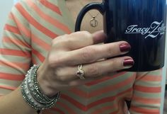 A #TZJMUGSHOTS from Carrie includes a pretty pink sapphire ring (from her thoughtful husband!), wrap bracelets from Story and Good Works, and a rose gold Great One Divine pendant!