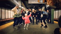 The crowd who spontaneously joined this little girl's dance at a NYC subway stop.