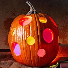 """Stained Glass Pumpkin  Let the kids help make the """"stained glass windows"""" by adhering self-laminating sheets to construction paper."""
