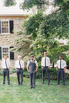 Groom with groomsmen wearing skinny black ties and grey vest