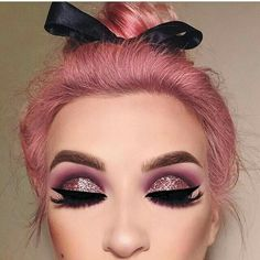 Pink hair and glittery pink  eye makeup are perfect for each other