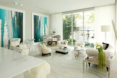 Brightening up interior spaces with floor to ceiling windows and invite light into the home.