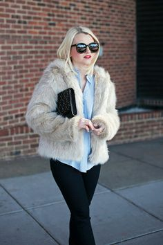 Faux fur coat with casual shirt and skinny jeans