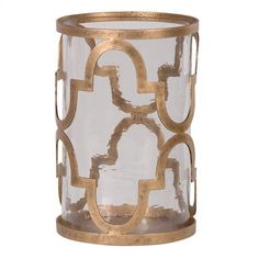 Marrakech Moorish Hurricane - Old Gold: With its antique gold finished frame and clear textured glass cylinder, this hurricane will enhance any interior. The perfect gift.
