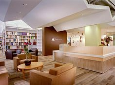 Reception area: brown w/tint of lime green; shelves, plush seating