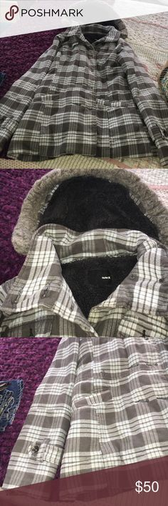 Plaid coat Plaid Hurley pea coat size large gray and blue plaid has fleece material on the inside it's very soft and in the hood has a fur trim around the hood it's very warm and comfortable and it's in good condition Hurley Jackets & Coats Pea Coats
