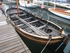 wood boat types | This is a reproduction of a Viking ship using only pine tar and ...