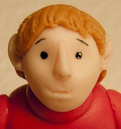 A great tutorial on sculpting people out of fondant