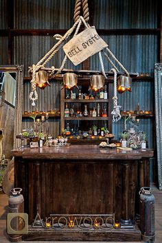 Arrowood Photography, Decor by Asiel Designs: rustic old world hip airplants steampunk metal wood industrial alchemist bar